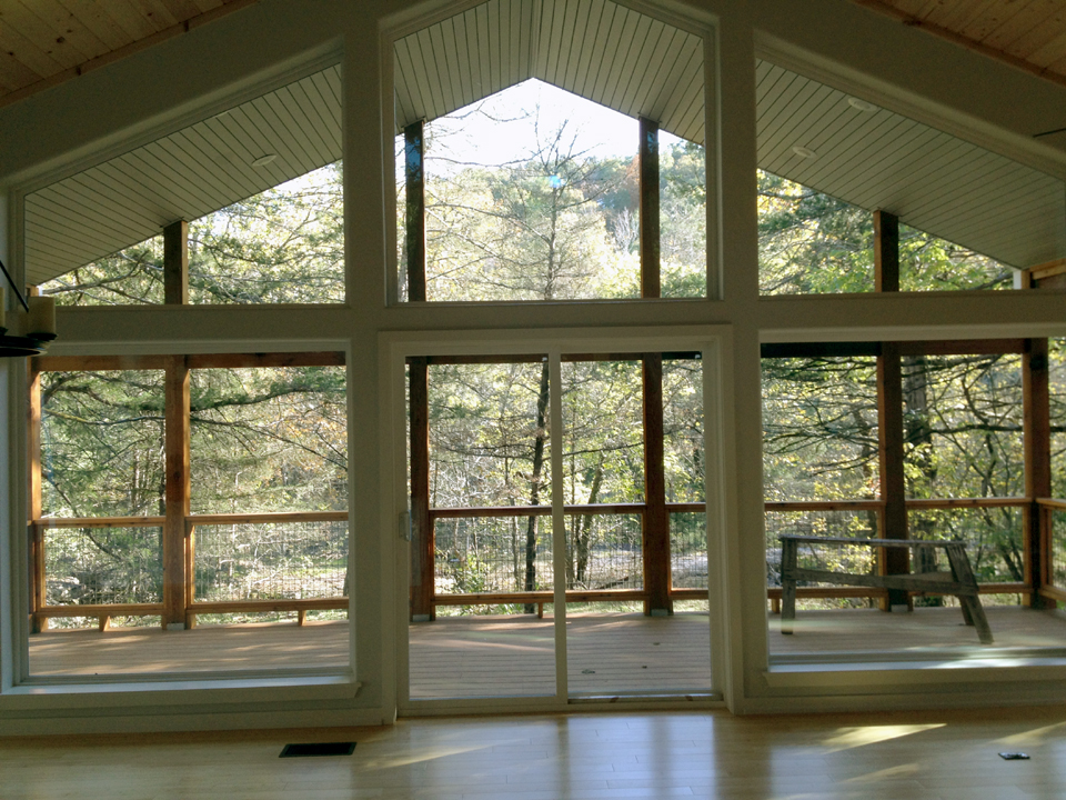 Sliding glass doors create a seamless indoor/outdoor transition.