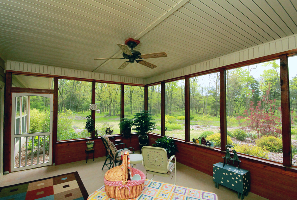 A screened porch is great for bug free outdoor living.
