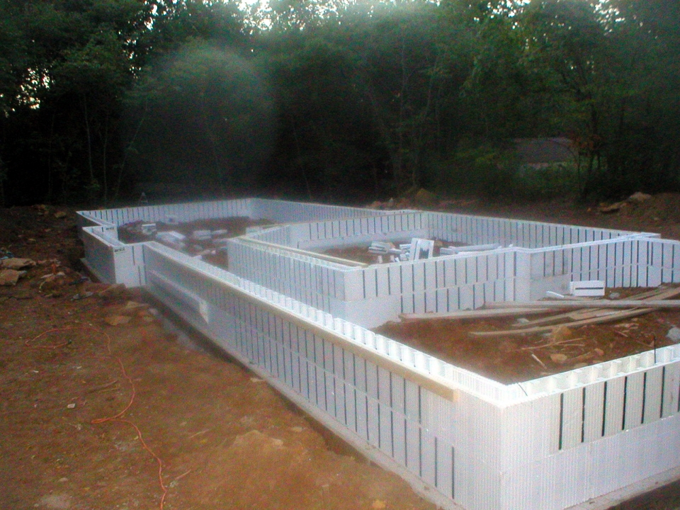 Insulated concrete forms are stacked over the footings and ready for concrete. These stay-in-place forms surround the slab and provide an insulated - and warmer - floor.